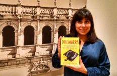 """Eileen Truax with the just released English translation of her book """"DREAMERS."""" Photo by Chris Jennewein"""