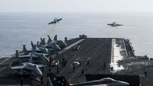 Two F/A-18F Hornet strike fighters launch from the aircraft carrier USS Carl Vinson in the Arabian Gulf. Navy photo