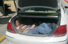 Border Patrol photo shows the two immigrants in the truck of the 2005 Acura RL.