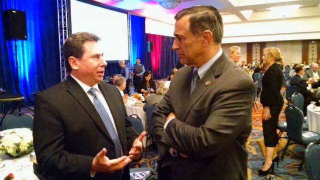 Rep. Darrell Issa speaks with Justin Becker of BAE Systems. Photo by Chris Jennewein