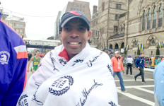 A smiling Meb Keflezighi warms up after finishing Boston Marathon. Image via Joe Giza on Twitter