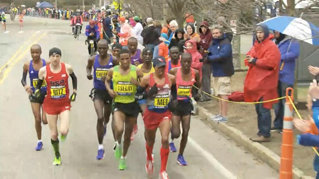 Meb Keflezighi led the pack late in the 2015 Boston Marathon, aiming to defend his 2014 title. Image via YouTube