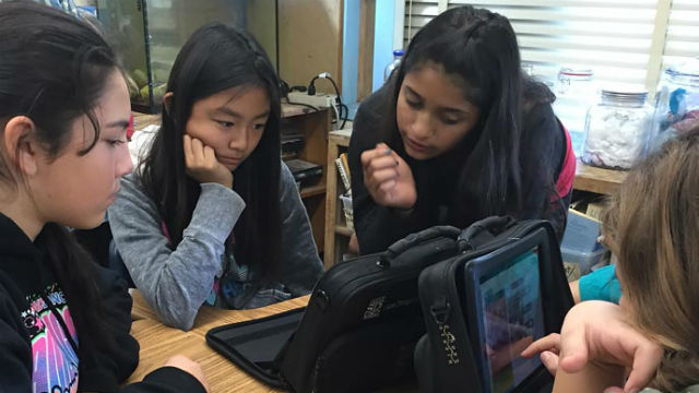 Students learning computer programming at Innovation Middle School . Courtesy San Diego Unified School District