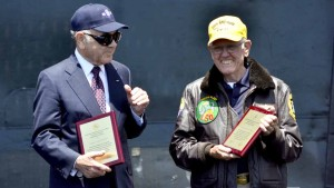 Larry Chambers, 1975 USS Midway Captain, left, and Vern Jumper, 1975 Midway Air Boss, received plaques for their service.
