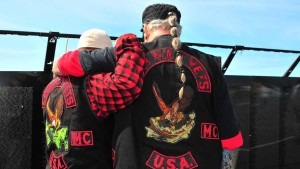 Veterans support each other while finding comrades' names on the memorial wall.