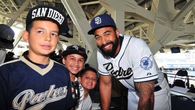 Newly acquired outfielder Matt Kemp, a fan favorite, poses with young fans. Photo by Chris Stone