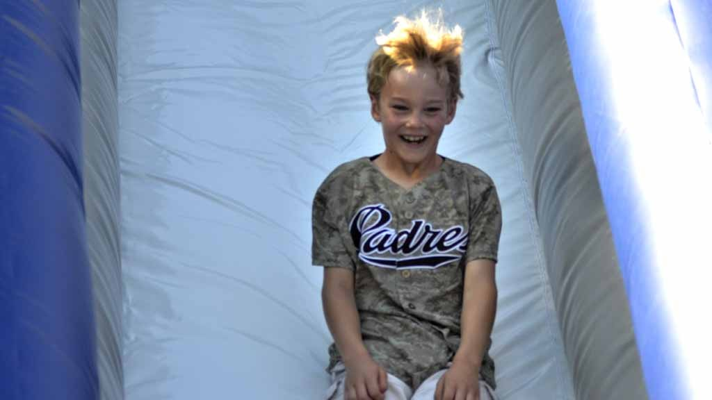 fe54d3550 A young fan enjoys the inflatable slide at the Park at the Park at Padres  FanFest 2015.