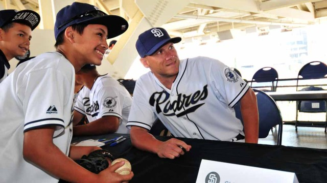 Infielder Clint Barmes poses for a photo with a fan at Padres FanFest 2015.  Photo by Chris Stone