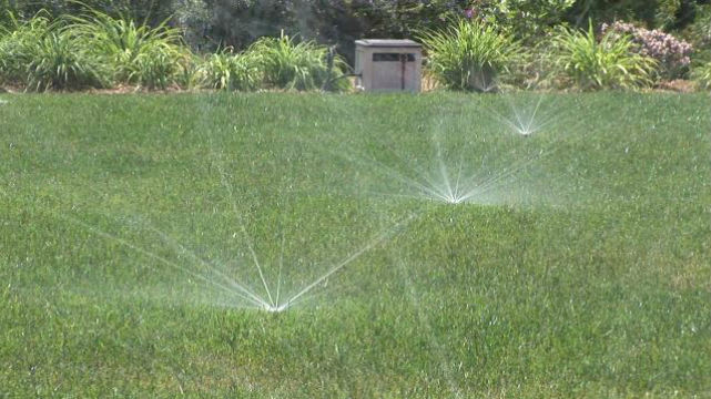Sprinklers watering a Southern California lawn. Courtesy Metropolitan Water District