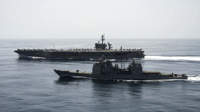 The USS Roosevelt and the USS Normandy in the Arabian Sea off Yemen. Photo courtesy of the Navy