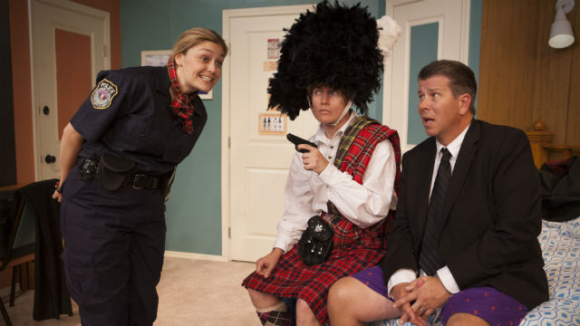 "Scene from ""Unnecessary Farce"" at the North Coast Repertory Theatre."