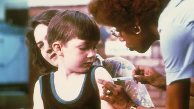 A nurse vaccinating a child. Courtesy CDC