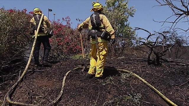 Vista firefighters mop up brush fire on Highway 78. Courtesy OnScene.TV