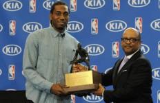 Kawhi Leonard accepts the Kia NBA Defensive Player of the Year Award on Thursday. Courtesy of sportal.com