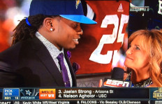 Running back Melvin Gordon, wearing a Chargers cap, is interviewed by ESPN's Suzy Kolber minutes after being selected by the Bolts at the 2015 NFL Draft. Image via ESPN