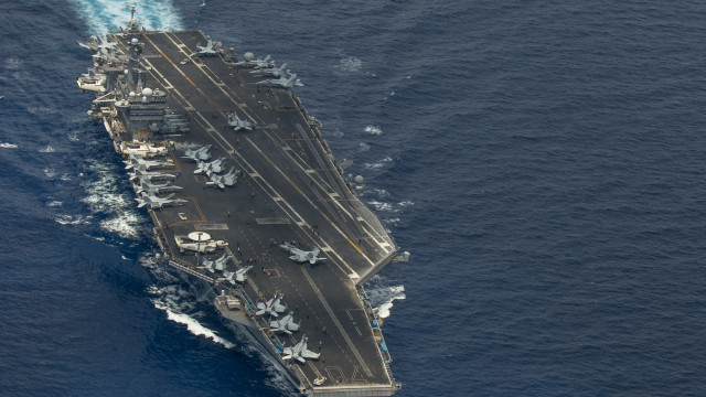 Two F/A-18 Super Hornets and two Royal Malaysian Air Force Mig 29 Fulcrums fly in formation above the aircraft carrier USS Carl Vinson (CVN 70). The Carl Vinson Strike group is deployed to 7th Fleet area of operations supporting security and stability in the Indo-Asia-Pacific region. (U.S. Navy photo by Mass Communication Specialist 2nd Class John Philip Wagner, Jr./Released)
