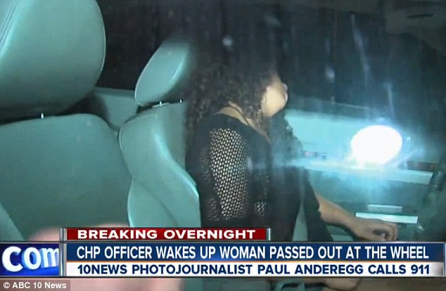 Amber McKinney Morgan captured by a news photographer allegedly passing out on the 805 freeway. Photo courtesy of 10 News