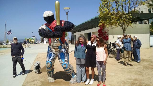 "Niki de Saint Phalle's granddaughter Bloum Cardenas (right), great-granddaughter Dawn Cardenas and daughter Laura Gabriela-Duke with ""#19 Baseball Player."" Photo by Chris Jennewein"