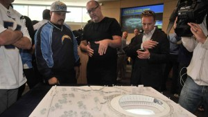 Dan Meis explains his model of Chargers stadium for the Mission Valley site.