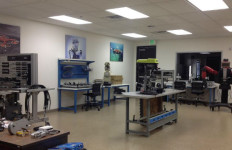 A Baxter robot (right) and other manufacturing tools at MiraCosta College's Technology Career Institute.