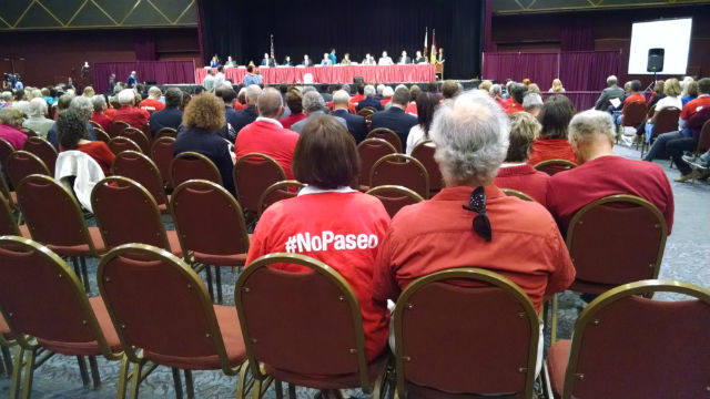 One Paseo opponents at the City Council meeting in Golden Hall. Photo by Chris Jennewein
