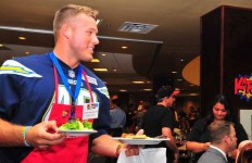 At the STAR/PAL Celebrity Waiter Luncheon Chargers outside linebacker Colton Underwood serves lunch to the attendees delight.