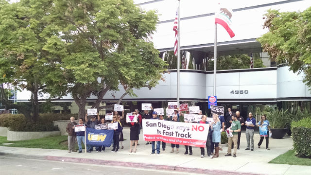Protesters gather outside Rep. Scott Peters' office in University City. Photo by Chris Jennewein