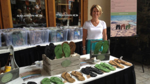 Terri Kelly stands with her products on display at Tahoe store. Image via terrykelly.com