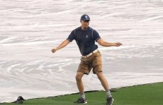 A Padres groundskeeper showing off his dance moves during a rain delay. Courtesy of Padres.com.