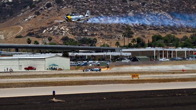 A vintage plane flies over Gillespie Field during AirShow 2014. Courtesy of AirShow San Diego
