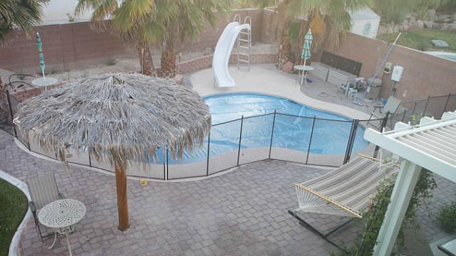 A backyard pool with a cover. Photo via Wikimedia Commons