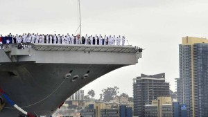 The USS Carl Vinson pulls into San Diego harbor after a 10-month deployment.