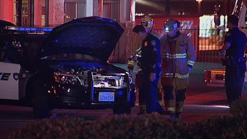 Carlsbad Police examine patrol car involved in shooting. Courtesy OnScene.TV