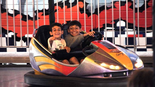 Kids 12 and younger get into the County fair free on Tuesdays. Children enjoy the bumper cars.
