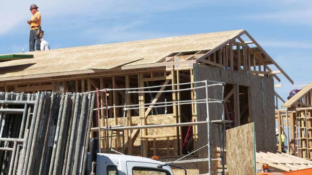 Volunteers from Lowe's, Clark Construction, the Jimmie Johnson Foundation and the community in conjunction with Habitat for Humanity are spending five days to build four homes for the needy in El Cajon.