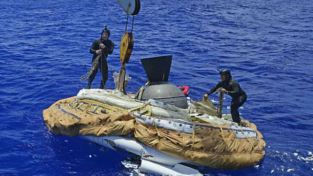 Sailors assigned to the Explosive Ordnance Detachment of Mobile Diving and Salvage Unit 1 recover the test vehicle for NASA's Low-Density Supersonic Decelerator off Kauai, Hawaii. Navy photo