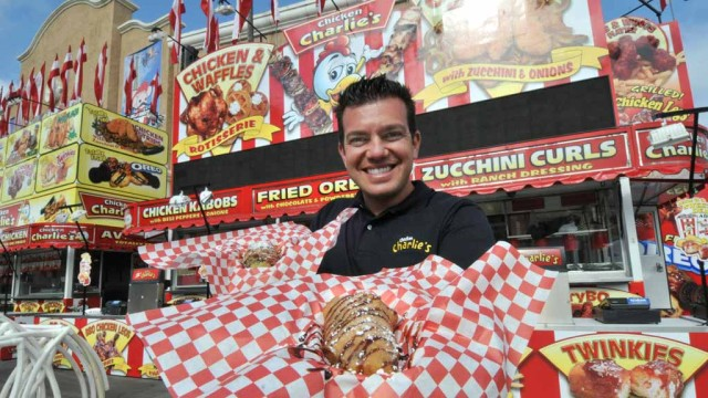 Tony Boghosian showing off the new food at Chicken Charlie's. Photo by Chris Stone