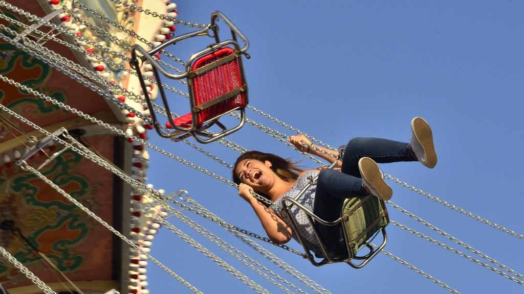 The swings and other rides in the Fun Zone attract many fairgoers during the day and especially at night.