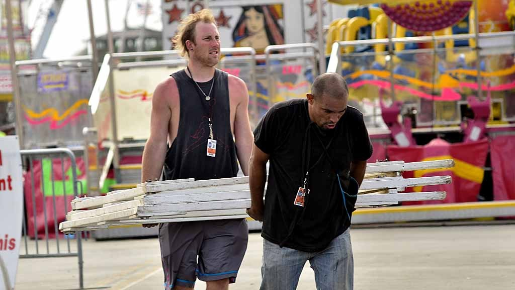 Booth operators prepare Wednesday for the Friday opening of the San Diego County Fair.