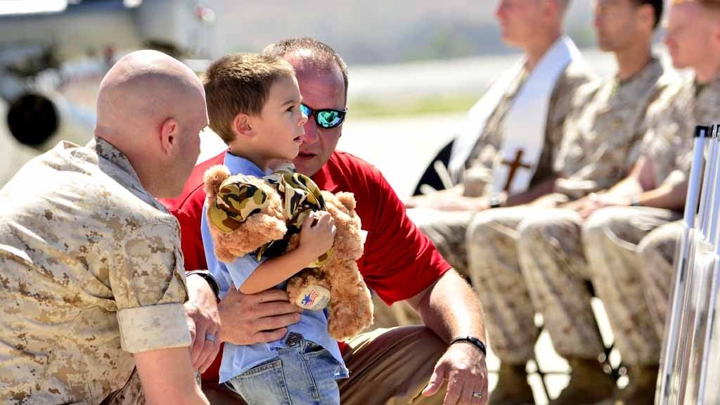 Young Nathan Johnson, whose father, Sgt. Ward M. Johnson IV, died in a helicopter crash in Nepal looks at the memorial at Camp Pendleton Wednesday.