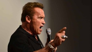 Schwarzenegger shouts one of his famous lines from one of his movie.