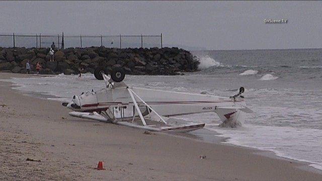 A plan, possibly carrying a banner, crash landed on a beach in Carlsbad. Photo courtesy of OnSceneTV