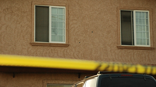 Bullet holes can be seen at the home on the 1500 block of Oleander Avenue. Photo by Alexander Nguyen