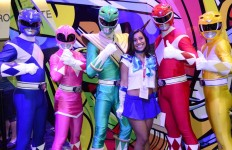 A fan poses with Power Rangers at Comic-Con. Chris Stone photo