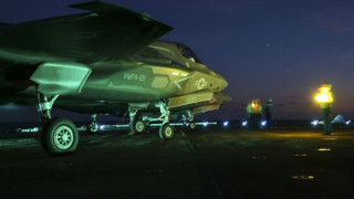 An F-35B prepares to taxi on the flight deck of the USS Wasp during night operations at sea as part of the first squadron's operational test in May. Marine Corps photo