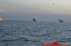 A salvo of three Longbow Hellfire missiles hits three targets off Virginia. Navy photo