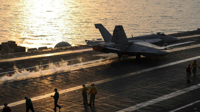 An F/A-18E Super Hornet launches from the flight deck of the aircraft carrier USS Theodore Roosevelt on Friday. Navy photo
