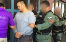 An Special Response Team from U.S. Immigration and Customs Enforcement deporting a Mexican fugitive. Courtesy ICE