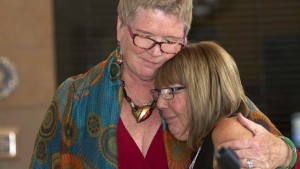 Councilwoman Marti Emerald embraces Democratic club President Linda Armacost after plaque presentation. Chris Stone photo