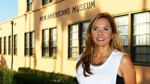 Linda Caballero-Sotelo in front of the New Americans Museum. Photo by Leticia Gomez Franco